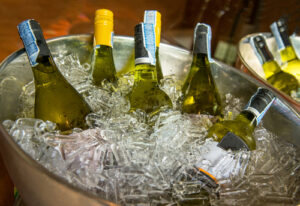 Bottles,Of,White,Wine,On,Ice,Bucket,At,A,Party.
